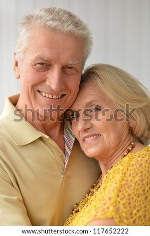 Portrait of a nice elderly couple posing in the room