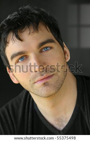 Portrait of a nice young attractive man with blue eyes
