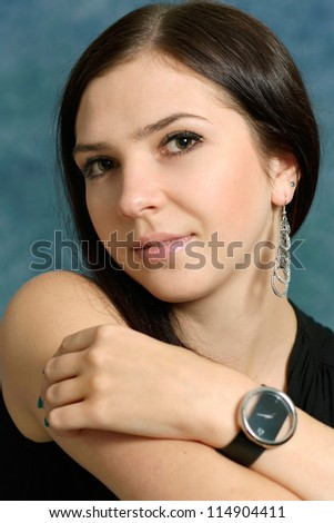 portrait of a nice young girl posing on a blue