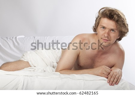 stock photo portrait of a nude man relaxing in bed studio image see more in my portfolio 62482165 jessica biel naked