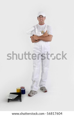 Portrait of a painter in overalls  on white background