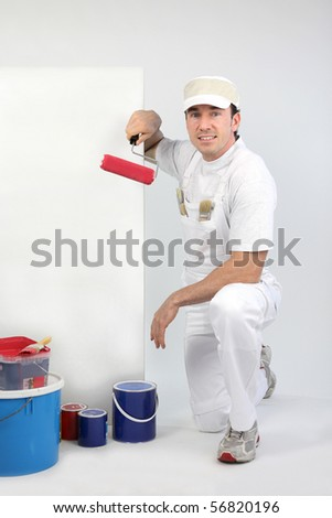 Portrait of a painter with roller brush on white background