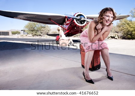 Portrait of a patient passenger, waiting for her flight. laughing happily. In the background, a classic 1930's private plane