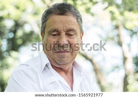 Portrait of a Pensive senior man Outdoors