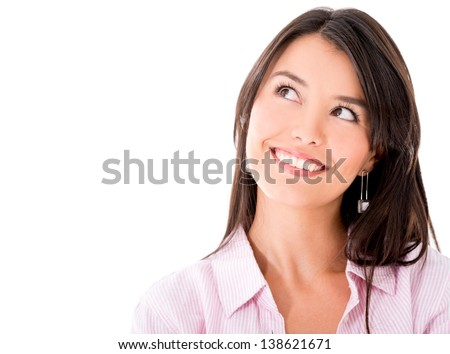 Portrait of a pensive woman smiling - isolated over white