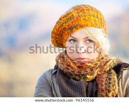 Portrait of a pensive young woman outdoor in the countryside.
