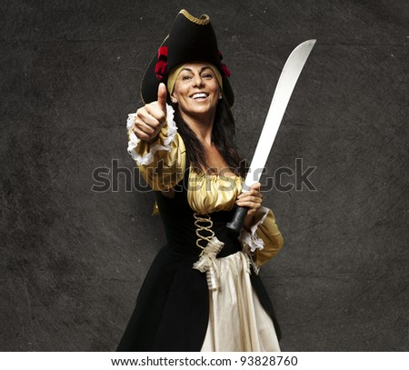 portrait of a pirate woman holding a sword and gesturing an ok symbol against a grunge background