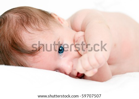 Portrait of a playing baby - stock photo