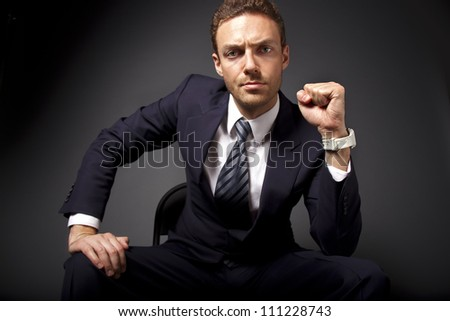 Portrait of a powerful businessman showing his strength.