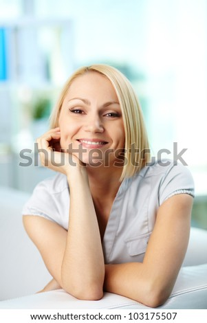 Portrait of a pretty blonde smiling at camera