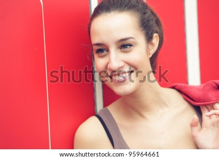 Portrait of a pretty female during a break from gym