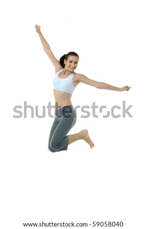 Portrait of a pretty girl exercising *-jumping