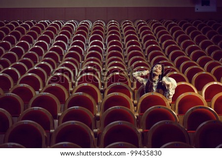 portrait of a pretty girl in a movie theater
