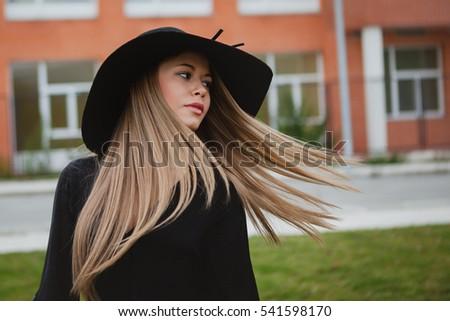 Portrait of a pretty girl wearing stylish hat  #541598170