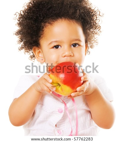 Portrait of a pretty little girl with a red apple on white background