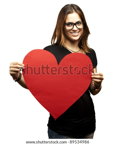 portrait of a pretty woman holding a paper heart against a white background