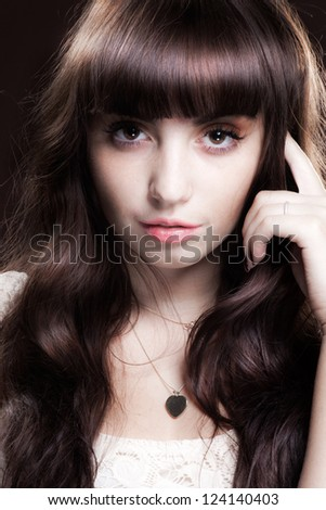 portrait of a pretty young brunette posing in  studio