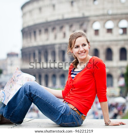 Portrait of a pretty, young, female tourist in Rome, Italy (with Colosseum in the background)