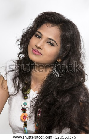 ... of a pretty young Indian girl on white background. - stock photo