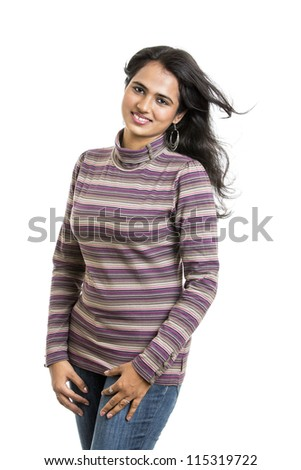 Portrait of a pretty young Indian girl with hair lightly fluttering in the wind