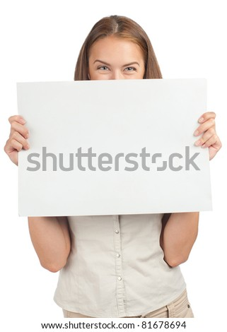 Portrait of a pretty young woman peeking over blank billboard, isolated on white background