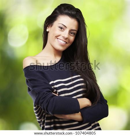 portrait of a pretty young woman smiling against a nature background