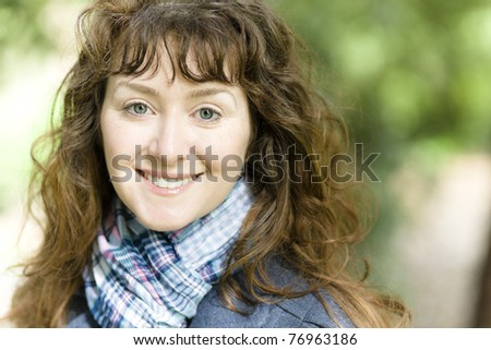 Portrait of a Pretty Young Woman Smiling Directly to the Camera