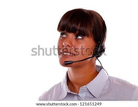 Portrait of a pretty young woman with earphone looking up on isolated background copyspace
