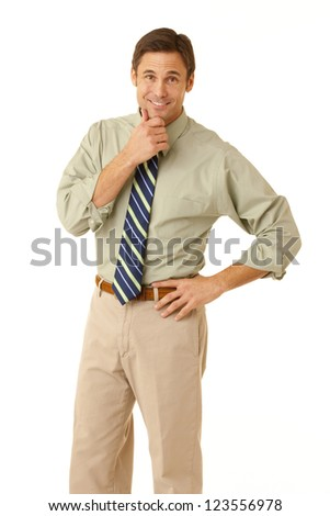 Portrait of a professional business person wearing a shirt and tie standing gesturing with his hand near his mouth isolated on white background