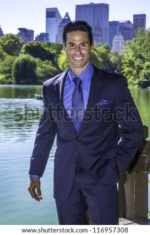 Portrait of  a professional executive. The background is a beautiful business district environment.