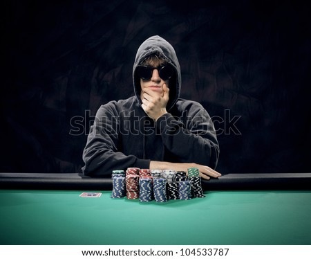 Portrait of a professional poker player sitting at a poker table