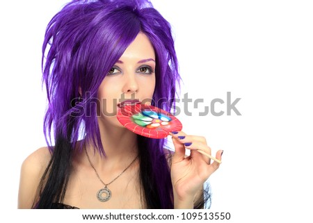 Portrait of a punk girl with a lollipop. Isolated over white background. - stock photo
