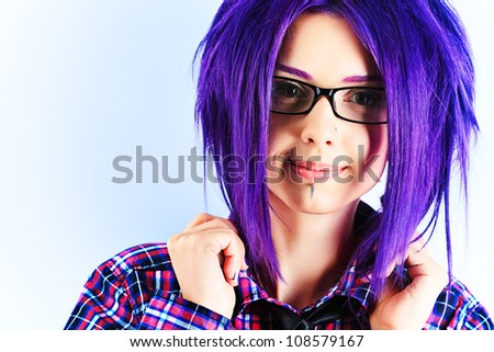 Portrait of a punk girl with purple hair.