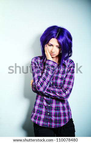 Portrait of a punk girl with purple hair. - stock photo