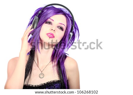 Portrait of a punk girl with purple hair listening to music.