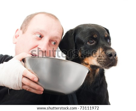 portrait of a purebred  rottweiler Refusing meal in studio