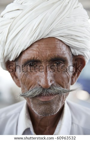 Portrait of a Rajasthani Indian man with turban and a typical Rajasthani style beard.