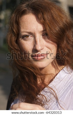 portrait of a red haired woman