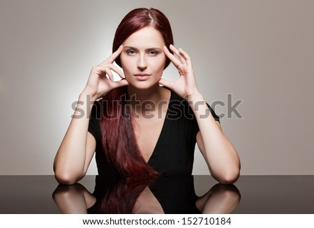 Portrait of a redhead beauty with strong facial expression.