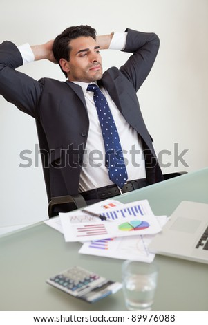 Portrait of a relaxed sales person in his office