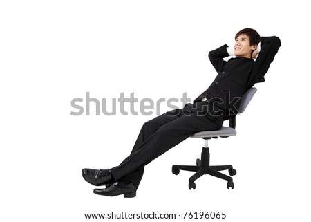 Portrait of a relaxed young businessman sitting on the chair and isolated on white