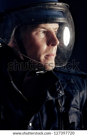 Portrait of a riot policeman wearing a helmet