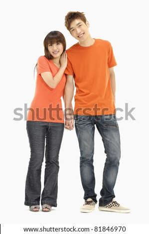 Portrait of a romantic young couple standing together over