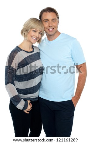 Portrait of a romantic young couple standing together over white background.