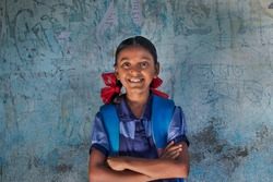 portrait of a rural school girl Smiling and standing in School