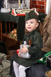 Portrait of a russian child girl in uniform. Holiday Victory Day May 9th