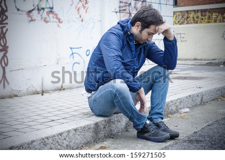 portrait of a sad man in a urban street stock photo