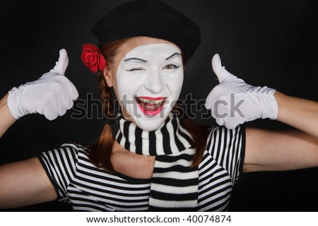 Portrait of a sad mime comedian,on black background