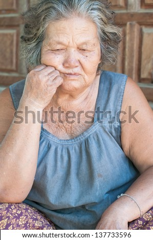 Portrait of a sad old woman with a sad nostalgic expression