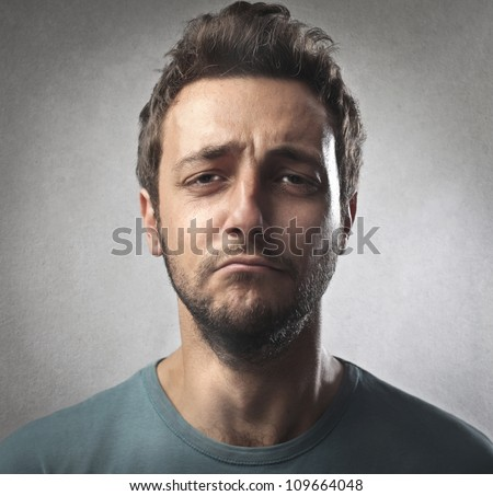 Portrait of a sad young man